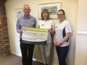 Julie Whinn & Emma Joyeux presenting a rather large cheque to Dave Gibson from the Great North Air Ambulance