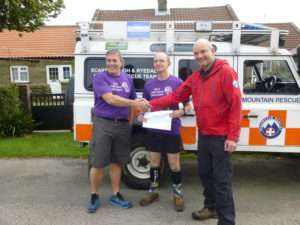 Anthony and Roy presenting the cheque